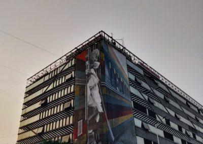 Gray building under gray sky